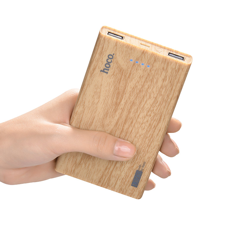 b12b 13000 wood grain power bank in hand